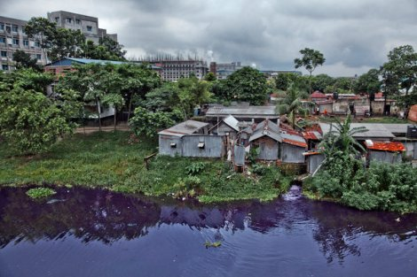 In Savar, an industrial suburb of Dhaka, Bangladesh, and the site of the deadly Rana Plaza building collapse, many factories do not treat their wastewater, as the purple canal makes clear. The building to the left partly hidden by trees is an elementary school, where the stench of the water sometimes makes the students ill.